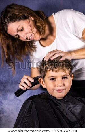 Little boy getting haircut at barber Stock photo © colematt