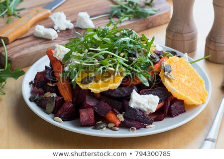 Vegetable salad - baked red beets and carrots, oranges, arugula, goat cheese Stock photo © madeleine_steinbach
