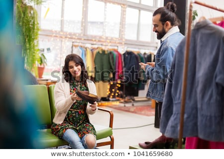 couple choosing footwear at vintage clothing store Stock photo © dolgachov