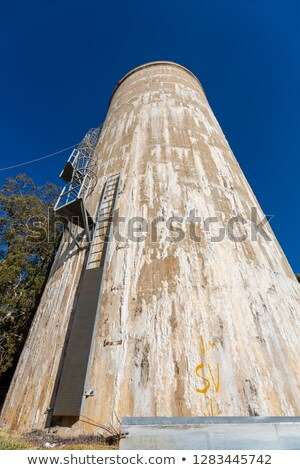 Old water tower with signs of Efflorescence seepage Stock photo © lovleah