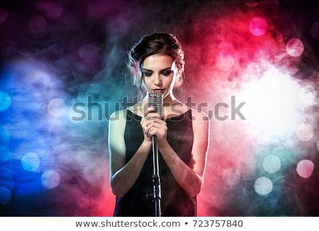 Mulher cantora microfone música concerto cena Foto stock © rogistok