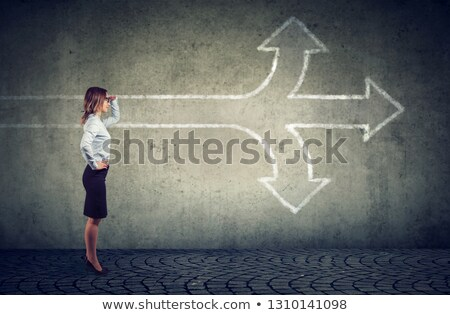 Confident businesswoman looking into the future at crossroads  Stock photo © ichiosea