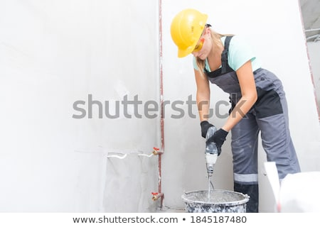 Builder knead concrete Stock photo © netkov1