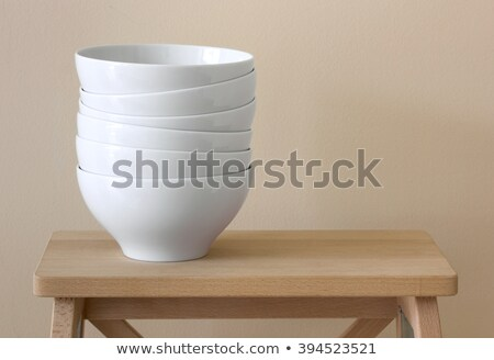 Stack of White Ceramic Dishes in the Room Stock photo © make