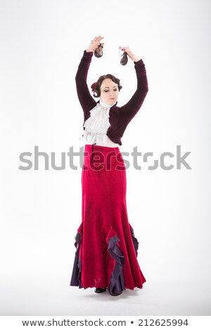 young woman dancing flameno with castanets on black stock photo © artjazz