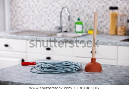 Plunger And Drainage Cable On Kitchen Worktop Stock photo © AndreyPopov