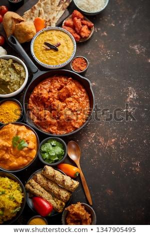 Würzig indian Brathähnchen serviert striegeln Gemüse Stock foto © dash