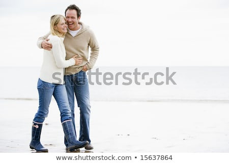 Wintertime Couple Man and Woman Walking Together Stock photo © robuart