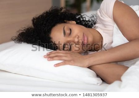 gülen · genç · kız · uyku · kanepe · ev · mutluluk - stok fotoğraf © lopolo