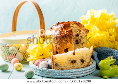 Slice of easter orthodox sweet bread, kulich end quail eggs. Сток-фото © Melnyk