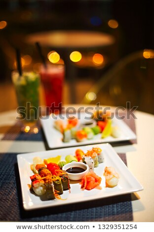 delicious japanese sushi mix and two mojitoes stock photo © dashapetrenko