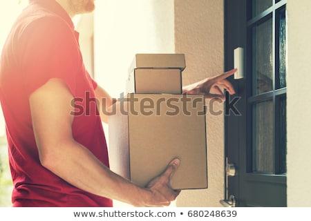 Man Holding Cardboard Box Ringing The Door Bell Stock photo © AndreyPopov