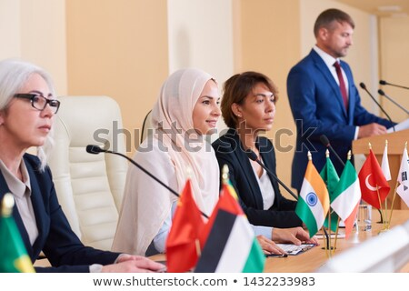 Pretty young muslim businesswoman listening to audience Stock photo © pressmaster