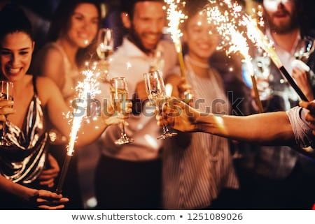 happy couple with champagne celebrating christmas stock photo © dolgachov