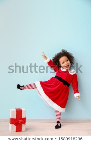 Cute kid in santa costume with gift Stock photo © nyul