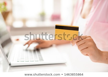 Plastic card in hand of young contemporary client of online shop Stock photo © pressmaster