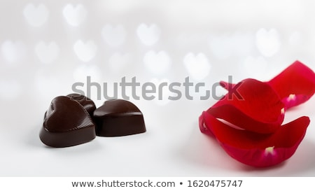 close up of calendar, heart, candies and red roses Stock photo © dolgachov