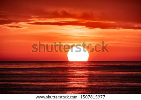 orange sunset over dark water stock photo © mycola