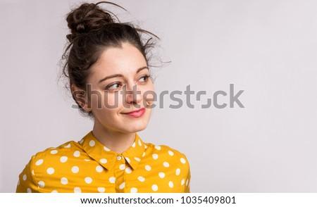 Closeup portrait of an attractive dark-haired woman Stock photo © konradbak