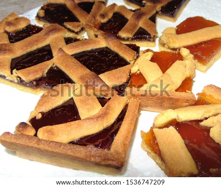 Fresh baked tarts with marmalade or apricot jam filling and on c Stock photo © marylooo