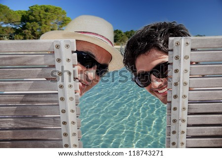 Father and son sat poolside Stock photo © photography33