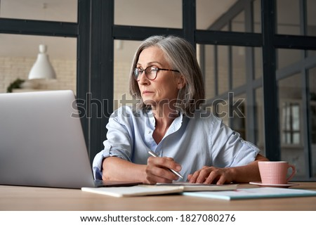 serious businesswoman taking notes stock photo © photography33