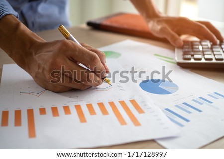 businessman looking critically at a report stock photo © photography33
