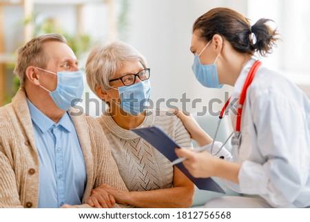 pár · orvosok · kórház · mosoly · orvos · gyógyszer - stock fotó © Minervastock