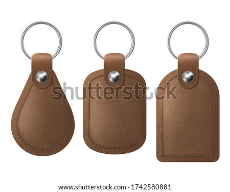 House key in leather holder Stock photo © nomadsoul1
