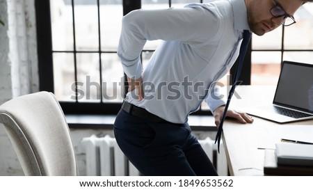 Businessman Having Backpain Stock photo © AndreyPopov