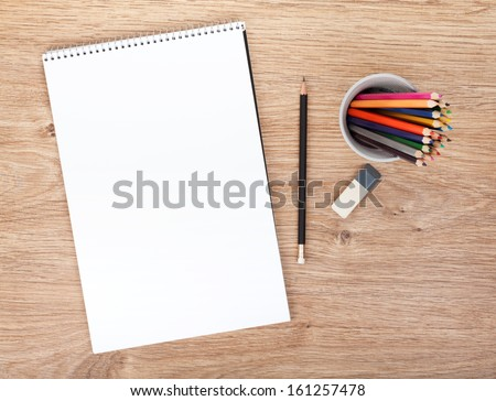 The blank sheet of paper on the wooden table with a pen  stock photo © master1305