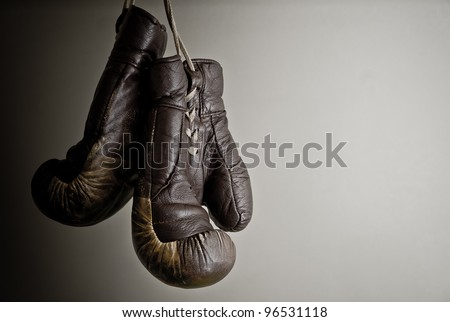 hang up the gloves, old worn leather boxing gloves. Stock photo © lithian