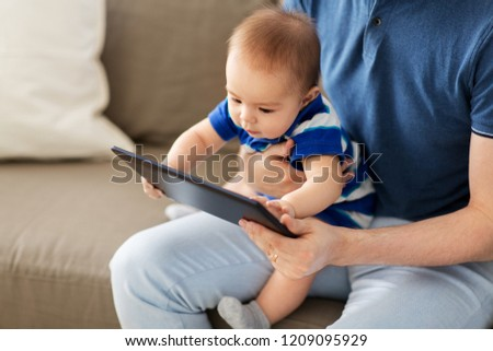 happy father and baby son with tablet pc at home Stock photo © dolgachov