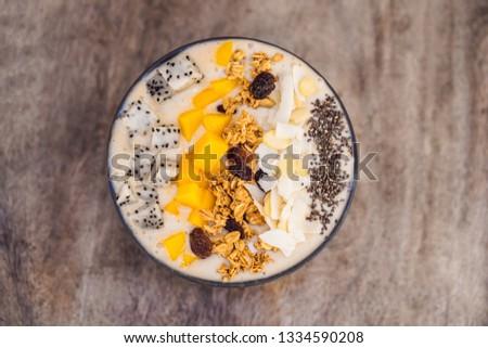 Smoothie bowls made with mango, banana, granola, grated coconut, Stock photo © galitskaya