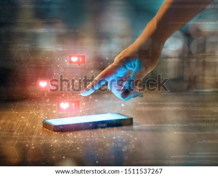 Young woman is using smartphone. Heart icons.  Stock photo © choreograph