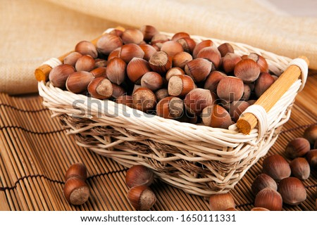 whole hazelnut kernels in a wicker basket still life Stock photo © mizar_21984