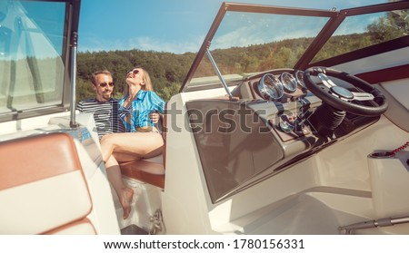 Woman and man enjoying some leisure time on a river boat Stock photo © Kzenon