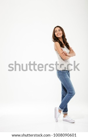 Sideways young woman posing Stock photo © stockyimages