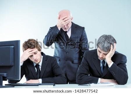 Csalódott üzleti csapat profi cégvezetők tart fej Stock fotó © Giulio_Fornasar