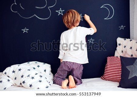 Stock photo: Boy and girl paint with chalk on a blackboard