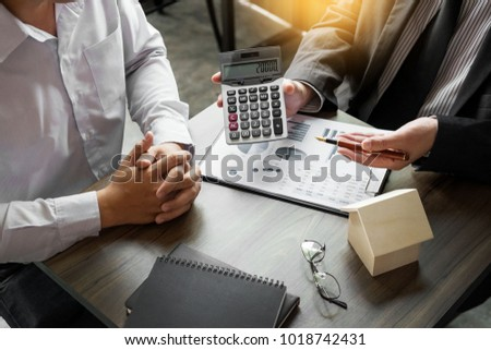 Real Estate concept, Agent with calculator for present price for Stock photo © snowing