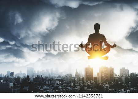 businessman sitting in lotus position on a cloud stock photo © vlad_star