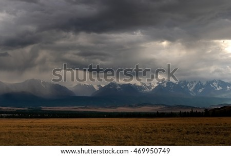 Severe mountains are covered by snow under dramatic sky Stock photo © Burchenko