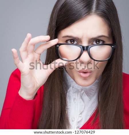 Image of beautiful brunette adult woman wondering and holding ce Stock photo © deandrobot