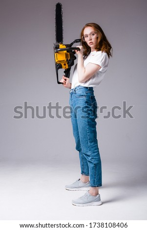 woman holding electrical saw stock photo © photography33