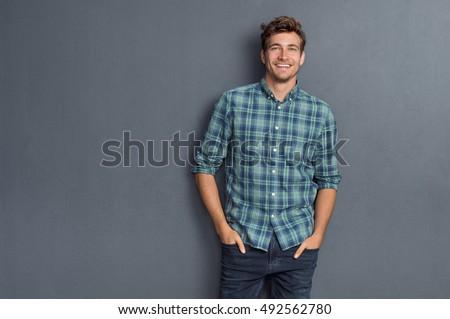 Mutlu yakışıklı adam bakıyor kamera eller cep Stok fotoğraf © wavebreak_media