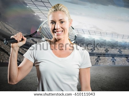 Stock photo: Tennis player smiling against stadium with bright lights and blue sky
