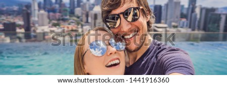 BANNER, LONG FORMAT young happy and attractive playful couple taking selfie picture together at luxu Stock photo © galitskaya