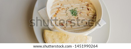 Puree soup with bread on white table BANNER, LONG FORMAT Stock photo © galitskaya