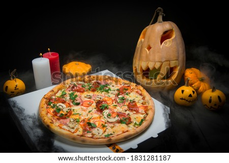 Halloween, Pumpkins in a box near Jack-o-Lantern and candles in green forest, outdoor Stock photo © Illia